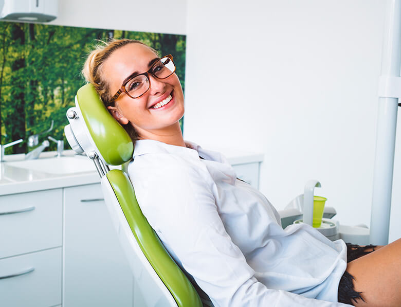 young woman sitting in a dental chair