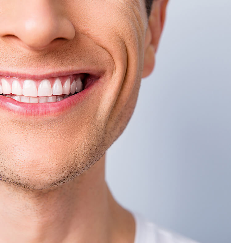 closeup of a man's bright, white smile